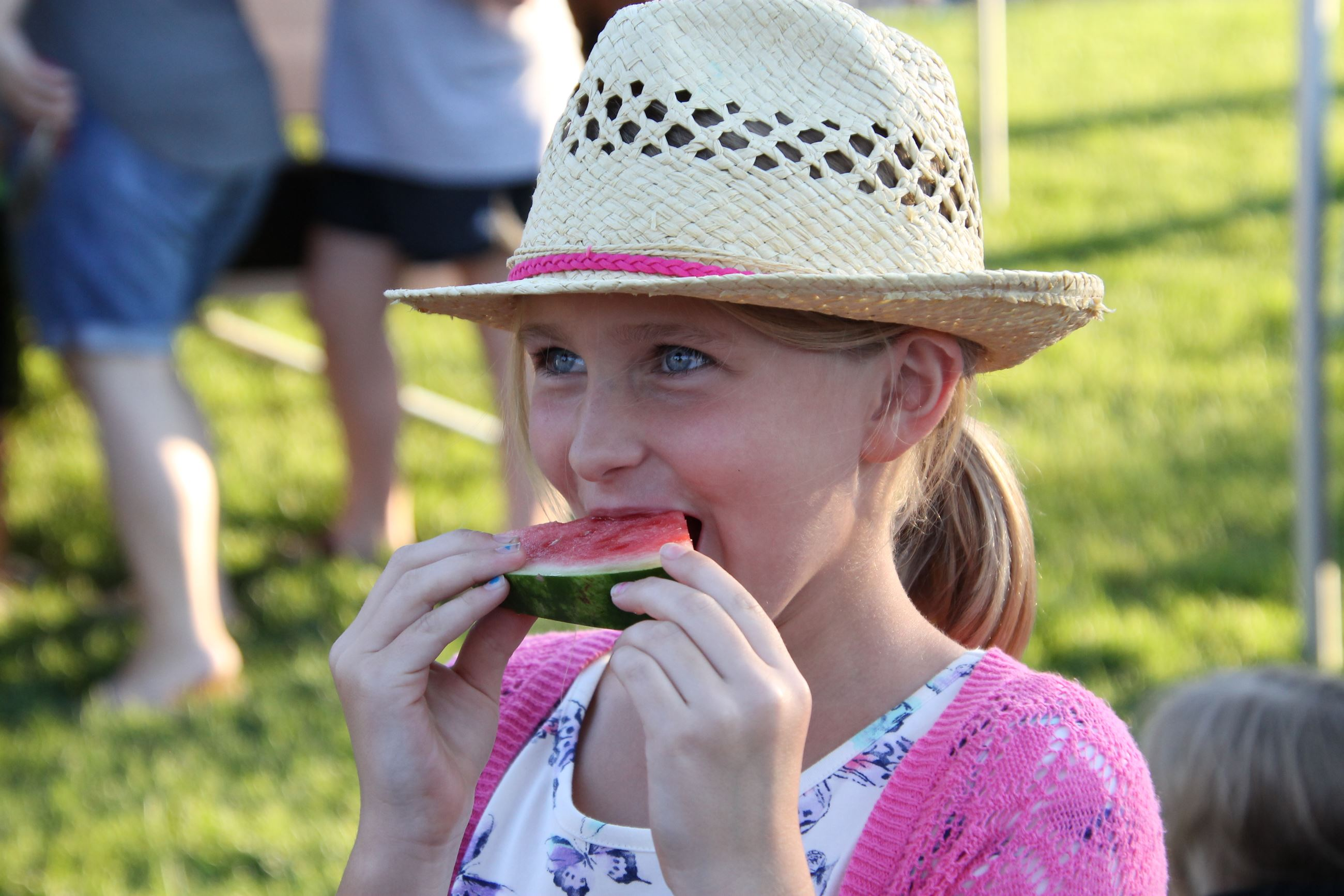 Girl eating a piece of watermelon