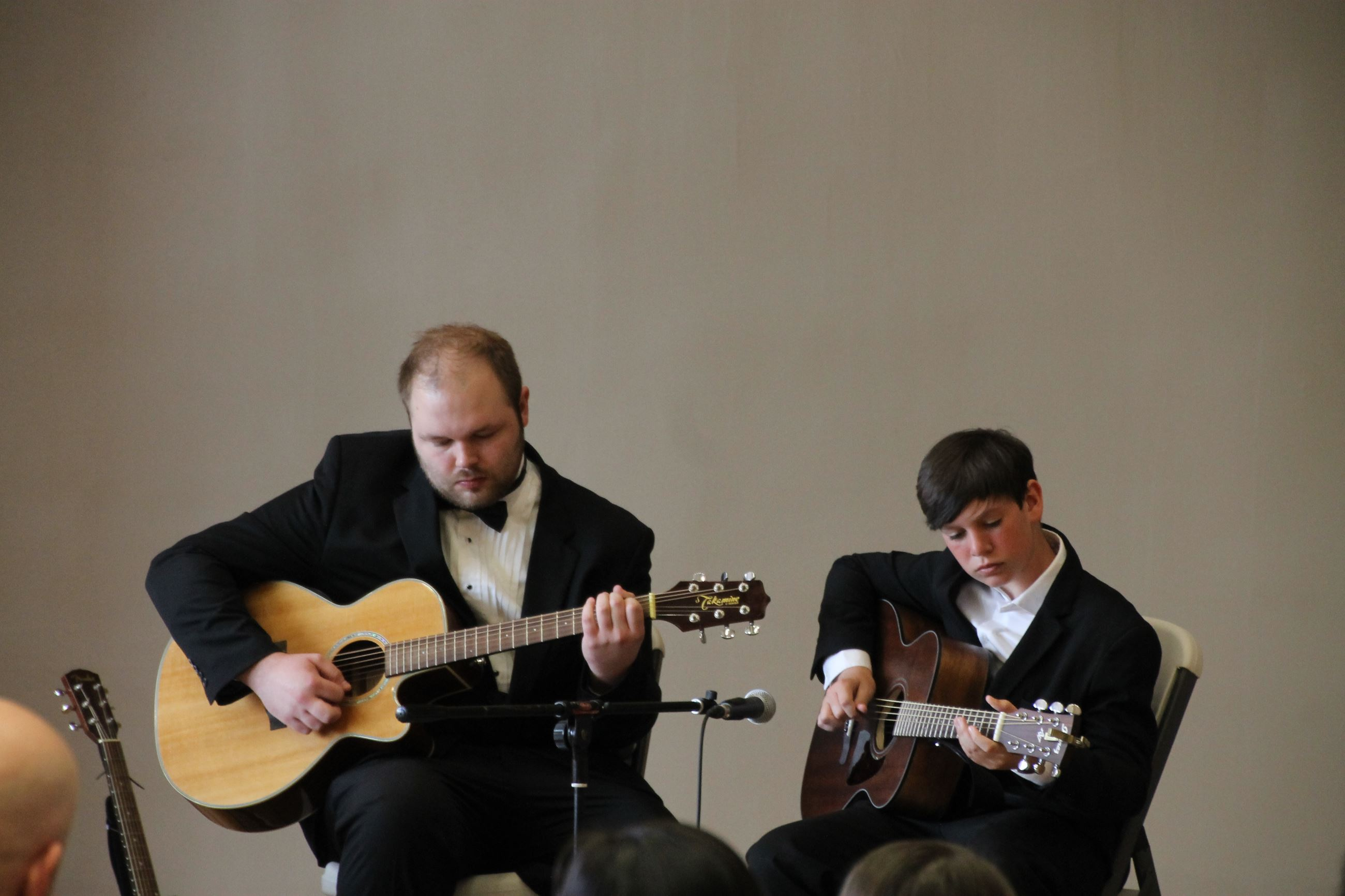 ARCC Music Program Recital Instructor and Student each playing guitar