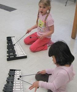 Youth playing instruments during music class